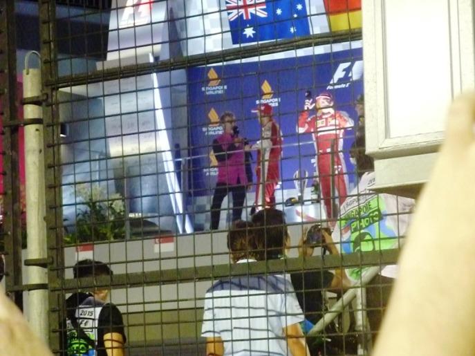 Eddie Jordan interviewing race winner Sebastian Vettel.