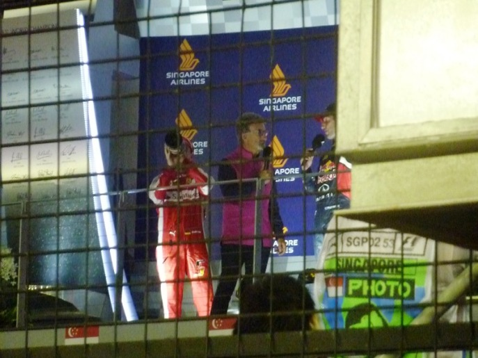 Eddie Jordan interviewing P2 Daniel Ricciardo. Notice how Vettel drank his champagne again!