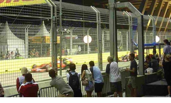 Vettel and Ricciardo passing by the Viewing Platforms opposite the T21 straight during the warm-up lap.